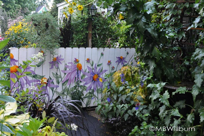 This garden fence perfectly foreshadows the enthusiasm and creativity of the garden on the other side. (Garden of Joe Hopkins & Scott Dunlap)