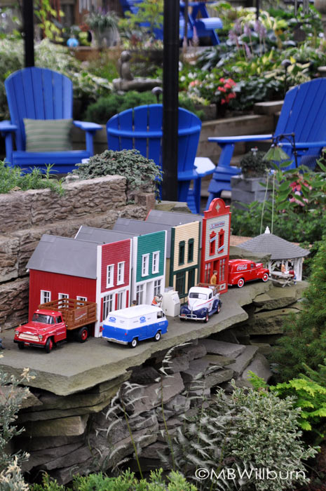 Gardens for your other hobby: a beautifully detailed train line runs through this miniature (and not so miniature) garden. (Garden of Barb and Dave Whittemore)